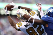 Benjamin Watson #82 of the New Orleans Saints attempts to make a completion but gets deflected by Landon Collins #21 of the New York Giants at MetLife Stadium on September 30, 2018 in East Rutherford, New Jersey.