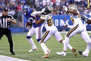 Odell Beckham #13 of the New York Giants stiff arms Marshon Lattimore #23 of the New Orleans Saints at MetLife Stadium on September 30, 2018 in East Rutherford, New Jersey.