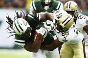 Chris Ivory #33 of the New York Jets runs against  Keenan Lewis #28 of the New Orleans Saints during their game at MetLife Stadium on November 3, 2013 in East Rutherford, New Jersey.