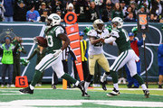 Chris Ivory #33 of the New York Jets scores a touchdown against the New Orleans Saints in the second quarter during their game at MetLife Stadium on November 3, 2013 in East Rutherford, New Jersey.