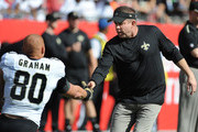 Head coach Sean Payton of the New Orleans Saints shakes hands with tight end Jimmy Graham #80 of the New Orleans Saints during pregame against the Tampa Bay Buccaneers at Raymond James Stadium on December 28, 2014 in Tampa, Florida.