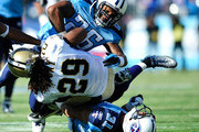 Chris Ivory #29 of the New Orleans Saints is tackled by Jordan Babineaux #26 and Cortland Finnegan #31 of the Tennessee Titans during play at LP Field on December 11, 2011 in Nashville, Tennessee.