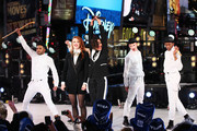 Caroline Hjelt and Aino Jawo of Icona Pop perform on stage ahead of midnight at The New Year's Eve 2014 Celebration in Times Square on December 31, 2013 in New York City.