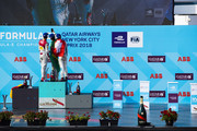 In this handout provided by FIA Formula E, Daniel Abt (GER), Audi Sport ABT Schaeffler, Audi e-tron FE04, Lucas Di Grassi (BRA), Audi Sport ABT Schaeffler, Audi e-tron FE04, and Sébastien Buemi (SUI), Renault e.Dams, Renault Z.E 17, celebrate on the podium during the New York City ePrix, Round 11 of the 2017/18 FIA Formula E Series on July 14, 2018 in New York, United States.