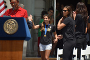 Robin Robbins (L) and Mayor Bill de Blasio celebrate soccer player Tobin Heath (C) and the World Cup Champions U.S. Women's Soccer National Team at a City Hall ceremony following a New York City Ticker Tape Parade on July 10, 2015 in New York City.