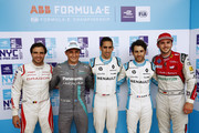 In this handout provided by FIA Formula E, Jérôme d'Ambrosio (BEL), Dragon Racing, Penske EV-2, Mitch Evans (NZL), Panasonic Jaguar Racing, Jaguar I-Type II, Sébastien Buemi (SUI), Renault e.Dams, Renault Z.E 17, Nicolas Prost (FRA), Renault e.Dams, Renault Z.E 17, and Daniel Abt (GER), Audi Sport ABT Schaeffler, Audi e-tron FE04, celebrate after qualifying during the New York City ePrix, Round 11 of the 2017/18 FIA Formula E Series on July 14, 2018 in New York, United States.