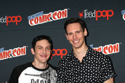 """Robin Lord Taylor and Cory Michael Smith of """"Gotham"""" attend New York Comic Con 2015 - Day 4 at The Jacob K. Javits Convention Center on October 11, 2015 in New York City."""