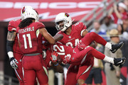 wide receiver John Brown #12 of the Arizona Cardinals is carried off the field in celebration by tight end Jermaine Gresham #84 after scoring a fifteen yard touchdown in the second half against the New York Giants at University of Phoenix Stadium on December 24, 2017 in Glendale, Arizona.