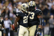 C.J. Spiller #28 of the New Orleans Saints celebrates a touchdown with Jahri Evans #73 following a late touchdown against the New York Giants at the Mercedes-Benz Superdome on November 1, 2015 in New Orleans, Louisiana.