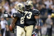 C.J. Spiller #28 of the New Orleans Saints celebrates with Jahri Evans #73 of the New Orleans Saints after scoring a touchdown against tehe New Orleans Saints at Mercedes-Benz Superdome on November 1, 2015 in New Orleans, Louisiana.