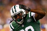 Chris Ivory #33 of the New York Jets rushes the ball against the New York Giants during the second quarter of a preseason game at MetLife Stadium on August 22, 2014 in East Rutherford, New Jersey.