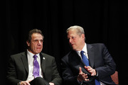 Former Vice President Al Gore (R) and New York Governor Andrew Cuomo sit on stage at an event at New York University, denouncing the Trump administration's proposal to open up new areas to offshore drilling, on March 9, 2018 in New York City. The two Democrats spoke on the negative environmental impact drilling, spills and underwater blasts could have on New York City.