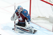 Goaltender Jonathan Bernier #45 of the Colorado Avalanche makes a save against the New York Islanders at the Pepsi Center on December 31, 2017 in Denver, Colorado. The Avalanche defeated the Islanders 6-1.
