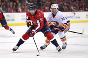 Evgeny Kuznetsov #92 of the Washington Capitals skates past Josh Bailey #12 of the New York Islanders during the second period at Capital One Arena on March 16, 2018 in Washington, DC.