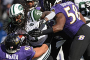 Running back Chris Ivory #33 of the New York Jets is tackled by a pack of Baltimore Ravens defenders in the first quarter at M&T Bank Stadium on November 24, 2013 in Baltimore, Maryland. The Baltimore Ravens won, 19-3.