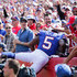 Tyrod Taylor Photos - Tyrod Taylor #5 of the Buffalo Bills celebrates with fans after scoring a touchdown in the second half against the New York Jets on September 10, 2017 at New Era Field in Orchard Park, New York. - New York Jets v Buffalo Bills