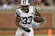 Chris Ivory #33 of the New York Jets looks to gain yards in the first quarter while playing the Buffalo Bills at Ford Field on November 24, 2014 in Detroit, Michigan.