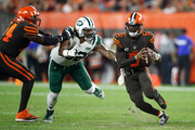Tyrod Taylor #5 of the Cleveland Browns carries the ball in front of the defense of Leonard Williams #92 of the New York Jets during the second quarter at FirstEnergy Stadium on September 20, 2018 in Cleveland, Ohio.
