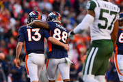 Quarterback Trevor Siemian #13 of the Denver Broncos and Demaryius Thomas #88 celebrate after a third quarter touchdown by Andy Janovich #32 (not pictured) against the New York Jets at Sports Authority Field at Mile High on December 10, 2017 in Denver, Colorado.