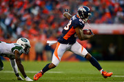 Wide receiver Demaryius Thomas #88 of the Denver Broncos runs after a catch under coverage by cornerback Morris Claiborne #21 of the New York Jets in the fourth quarter of a game at Sports Authority Field at Mile High on December 10, 2017 in Denver, Colorado.