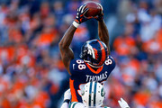 Wide receiver Demaryius Thomas #88 of the Denver Broncos catches a pass while being defended by cornerback Morris Claiborne #21 of the New York Jets during the first quarter at Sports Authority Field at Mile High on December 10, 2017 in Denver, Colorado.