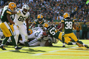 Running back Chris Ivory #33 of the New York Jets stretches the ball over the goal line to score a touchdown against the Green Bay Packers in the second quarter during the NFL game at Lambeau Field on September 14, 2014 in Green Bay, Wisconsin.