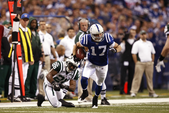 Austin Collie Austin Collie #17 of the Indianapolis Colts runs up the ...
