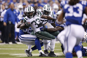 Chris Ivory #33 of the New York Jets battles for yardage against the Indianapolis Colts in the second quarter at Lucas Oil Stadium on September 21, 2015 in Indianapolis, Indiana.