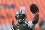 Quarterback Michael Vick #1 of the New York Jets throws during pregame workouts before the Jets met the Miami Dolphins at Sun Life Stadium on December 28, 2014 in Miami Gardens, Florida.