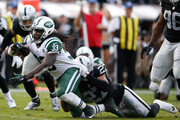 Chris Ivory #33 of the New York Jets is tackled by Taylor Mays #27 of the Oakland Raiders during their NFL game at O.co Coliseum on November 1, 2015 in Oakland, California.