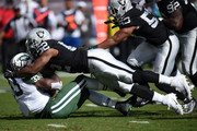 Chris Ivory #33 of the New York Jets is tackled by Khalil Mack #52 of the Oakland Raiders during their NFL game at O.co Coliseum on November 1, 2015 in Oakland, California.