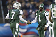 Michael Vick #1 congratulates Geno Smith #7 of the New York Jets after a touchdown during a game against the Tennessee Titans at LP Field on December 14, 2014 in Nashville, Tennessee.  The Jets defeated the Titans 16-11.