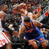 Paul Millsap Photos - Carmelo Anthony #7 of the New York Knicks drives against Paul Millsap #4 and Thabo Sefolosha #25 of the Atlanta Hawks at Philips Arena on January 5, 2016 in Atlanta, Georgia.  NOTE TO USER User expressly acknowledges and agrees that, by downloading and or using this photograph, user is consenting to the terms and conditions of the Getty Images License Agreement. - New York Knicks v Atlanta Hawks