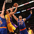 Jeremy Lin Photos - Jeremy Lin #17 of the Los Angeles Lakers makes a reverse layup over Andrea Bargnani #77 and Cole Aldrich #45 of the New York Knicks at Staples Center on March 12, 2015 in Los Angeles, California.   NOTE TO USER: User expressly acknowledges and agrees that, by downloading and or using this photograph, User is consenting to the terms and conditions of the Getty Images License Agreement. - New York Knicks v Los Angeles Lakers