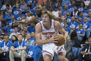 Ron Baker #31 of the New York Knicks drives around Raymond Felton #2 of the Oklahoma City Thunder during the second half of a NBA  game at the Chesapeake Energy Arena on October 19, 2017 in Oklahoma City, Oklahoma. NOTE TO USER: User expressly acknowledges and agrees that, by downloading and or using this photograph, User is consenting to the terms and conditions of the Getty Images License Agreement.