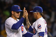 Anthony Rizzo #44 of the Chicago Cubs (L) cpongratulates Jesse Chavez #43 after a win over the New York Mets at Wrigley Field on August 27, 2018 in Chicago, Illinois. The Cubs defeated the Mets 7-4.