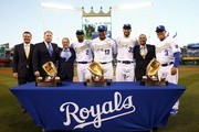 Alicedes Escobar #2, Salvador Perez #13 and Eric Hosmer #35 of the Kansas City Royals are presented with their Gold Glove trophies prior to the opening day game against the New York Mets at Kauffman Stadium on April 3, 2016 in Kansas City, Missouri.