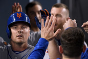 Jay Bruce #19 of the New York Mets celebrates his two run homerun in the dugout to take a 2-0 lead over the Los Angeles Dodgers during the second inning at Dodger Stadium on September 4, 2018 in Los Angeles, California.