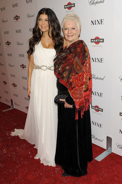 Singer Fergie (L) and Dame Judi Dench attend the New York premiere of