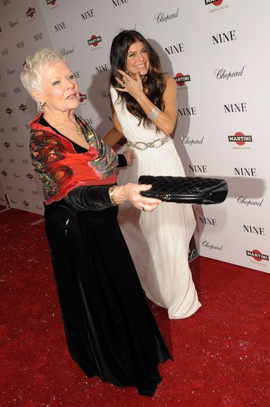 Actress Dame Judi Dench (L) and singer Fergie attend the New York premiere of