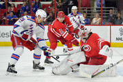 Chris Kreider #20 of the New York Rangers slips the puck past Cam Ward #30 of the Carolina Hurricanes for a goal during the first period of the game at PNC Arena on March 9, 2017 in Raleigh, North Carolina.
