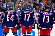 Head coach John Tortorella of the Columbus Blue Jackets waves over Tyler Motte #64, Brandon Dubinsky #17, and Cam Atkinson #13, all of the Columbus Blue Jackets, during a time out in the third period of the game against the New York Rangers on November 17, 2017 at Nationwide Arena in Columbus, Ohio. Columbus defeated New York 2-0.