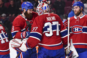 Jordie Benn #8 of the Montreal Canadiens congratulates goaltender Antti Niemi #37 for their victory against the New York Rangers during the NHL game at the Bell Centre on February 22, 2018 in Montreal, Quebec, Canada.  The Montreal Canadiens defeated the New York Rangers 3-1.
