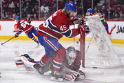 Joe Morrow #45 of the Montreal Canadiens skates into goaltender Antti Niemi #37 against the New York Rangers during the NHL game at the Bell Centre on February 22, 2018 in Montreal, Quebec, Canada.  The Montreal Canadiens defeated the New York Rangers 3-1.