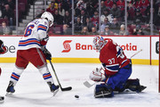 Goaltender Antti Niemi #37 of the Montreal Canadiens makes a pad save near Mats Zuccarello #36 of the New York Rangers during the NHL game at the Bell Centre on February 22, 2018 in Montreal, Quebec, Canada.
