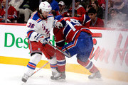 Mats Zuccarello #36 of the New York Rangers and Andrei Markov #79 of the Montreal Canadiens battle for the puck along the boards during Game Five of the Eastern Conference Final in the 2014 NHL Stanley Cup Playoffs at Bell Centre on May 27, 2014 in Montreal, Canada.