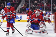Goaltender Antti Niemi #37 of the Montreal Canadiens makes a pad save near teammate Tomas Plekanec #14 of the Montreal Canadiens against the New York Rangers during the NHL game at the Bell Centre on February 22, 2018 in Montreal, Quebec, Canada.