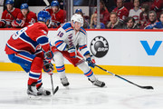 J.T. Miller #10 of the New York Rangers skates the puck against Andrei Markov #79 of the Montreal Canadiens during the NHL game at the Bell Centre on March 26, 2016 in Montreal, Quebec, Canada.