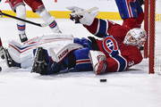 Goaltender Antti Niemi #37 of the Montreal Canadiens falls to the ice to defend his net from the puck in the first period against the New York Rangers during the NHL game at the Bell Centre on February 22, 2018 in Montreal, Quebec, Canada.  The Montreal Canadiens defeated the New York Rangers 3-1.