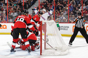 Referee Graham Skiliter #24 signals a first period goal by Michael Grabner #40 of the New York Rangers as Craig Anderson #41, Derick Brassard #19 and Cody Ceci #5 of the Ottawa Senators react at Canadian Tire Centre on February 17, 2018 in Ottawa, Ontario, Canada.